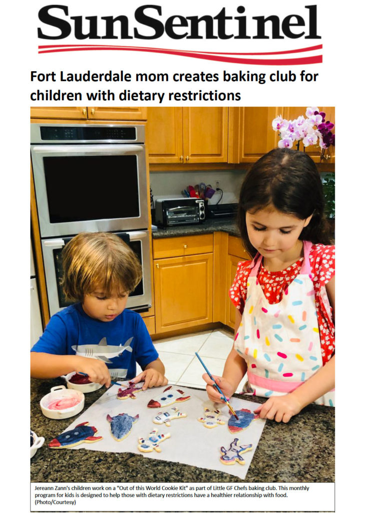 Boy and Girl painting cookies