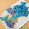 mermaid and whale cookies on a plate